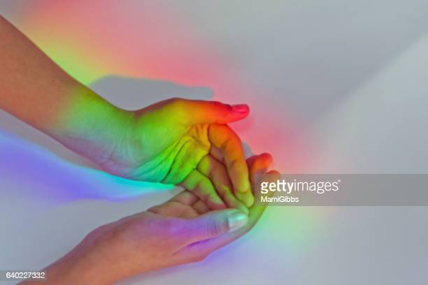Rainbow color light in the hands