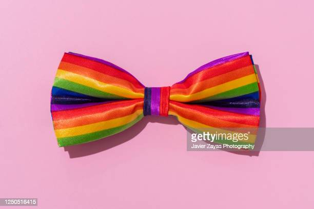 rainbow colored bow tie - bisexuality stock pictures, royalty-free photos & images