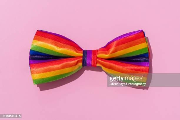 rainbow colored bow tie - bisexuality fotografías e imágenes de stock