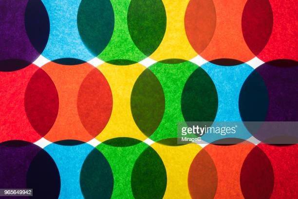 rainbow colored circle paper back-lit pattern - arranging stock pictures, royalty-free photos & images