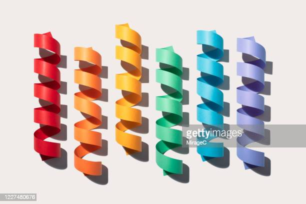 rainbow colored coiled paper stripes - colors of rainbow in order stock pictures, royalty-free photos & images