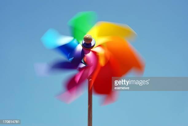 Rainbow colored pinwheel spinning fast