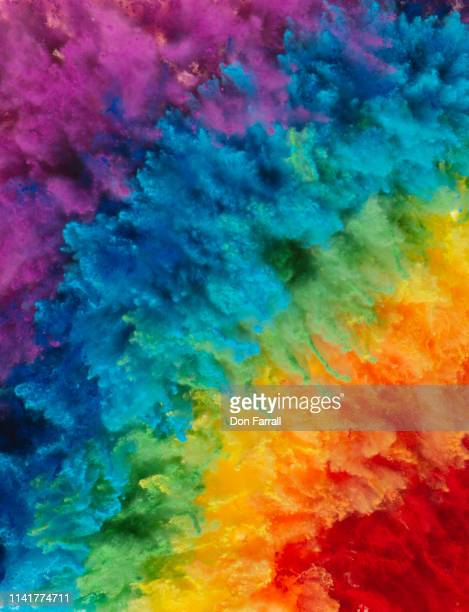 rainbow colored powder exploding - don farrall stock pictures, royalty-free photos & images