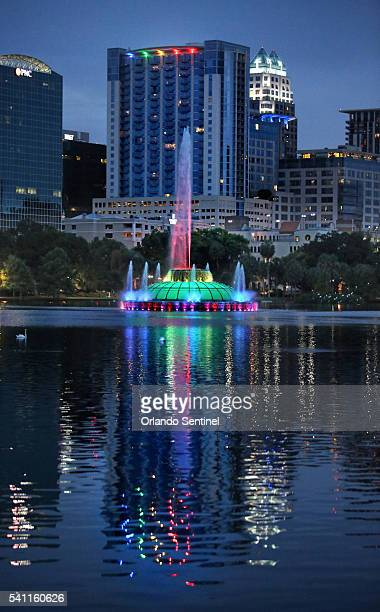 Rainbow colors are reflected on Lake Eola in downtown Orlando Fla from the city's iconic fountain and an adjacent office building on Saturday June 18...