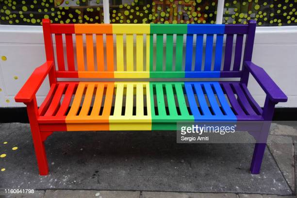 rainbow coloured bench - sergio amiti stock pictures, royalty-free photos & images
