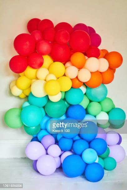 a rainbow coloured collection of balloons - social justice concept stock pictures, royalty-free photos & images