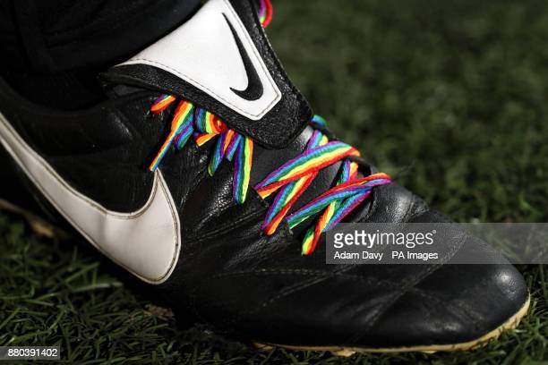 Rainbow coloured laces on Nike branded football boots at Loftus Road London