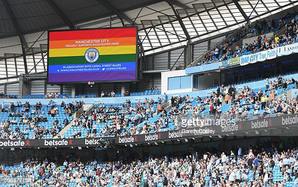 A rainbow coloured screen is pictured supporting Manchester Pride during the Premier League match between Manchester City and West Ham United at...