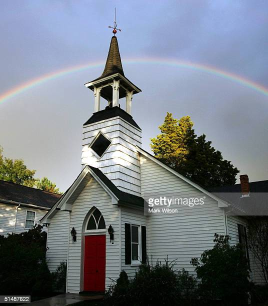 A rainbow crosses the sky behind Lower Marlboro United Methodist Church October 16 2004 in Owings Maryland The Washington DC metropolitan area...