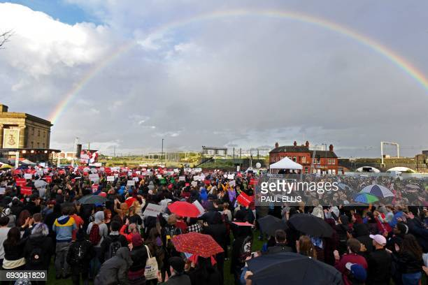 A rainbow cuts across the sky as supporters turn up to watch Britain's main opposition Labour Party leader Jeremy Corbyn speak at a general election...