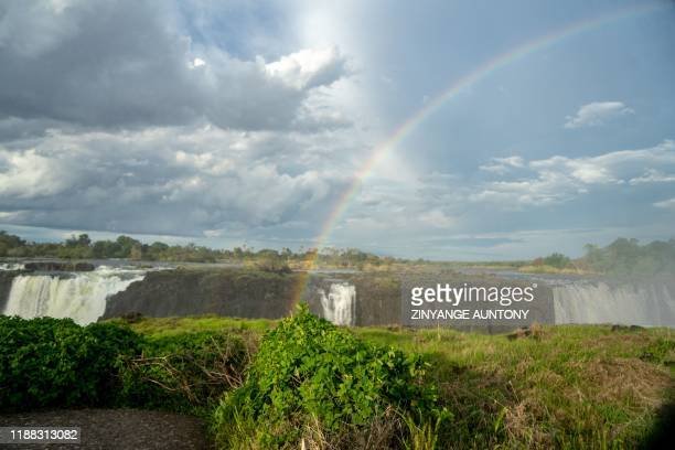 A rainbow emerges at the majestic Victoria Falls a tourism attraction for on December 10 2019 The Victoria Falls a UNESCO world heritage site...
