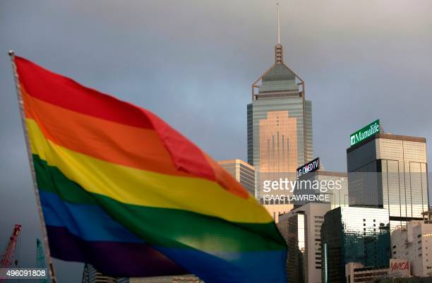 A rainbow flag a symbole of the Lesbian Gay Bisexual and Transgender community is seen in front of the city skyline in Hong Kong on November 6 2015...