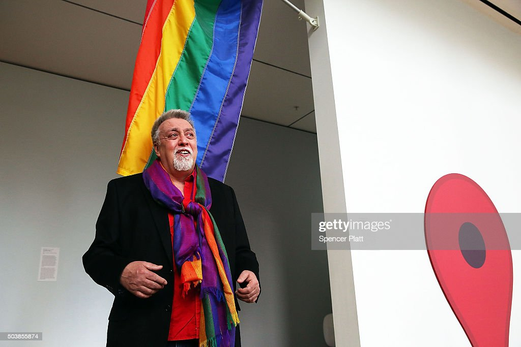 Rainbow Flag Creator Gilbert Baker poses at the Museum of Modern Art (MoMA) on January 7, 2016 in New York City. MoMa announced in June 2015 its acquisition of the iconic Rainbow Flag into the design collection. Baker, an openly gay artist and civil rights activist, designed the Rainbow Flag in 1978. The flag has since become a prominent symbol to the gay community around the world.
