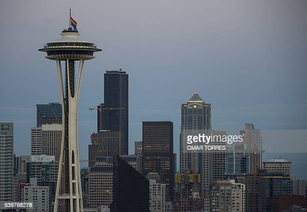 A rainbow flag flies at half mast on the Space Needle in Seattle Washington on June 12 in honor of the victims of the nightclub shooting in Orlando...