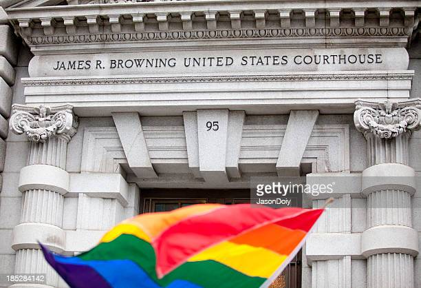 A rainbow flag in front of the James R. Browning Courthouse