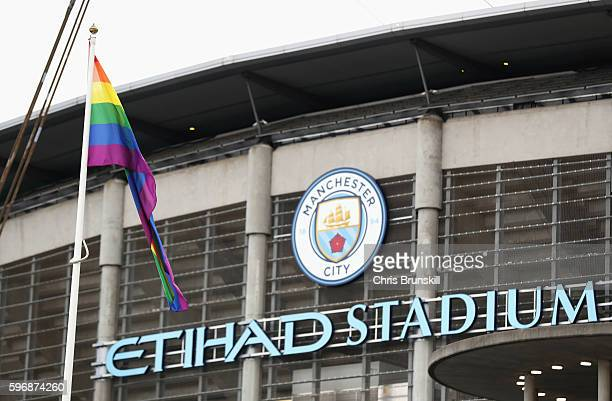 A rainbow flag is displayed outside the ground prior to the Premier League match between Manchester City and West Ham United at Etihad Stadium on...