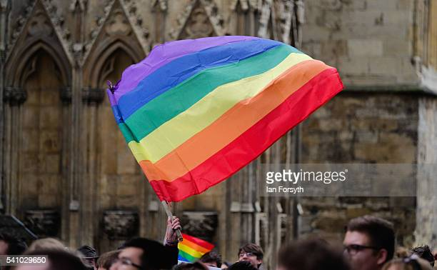 A rainbow flag is flown in front of York Minster as hundreds of people take part in the annual LGBT York Pride parade on June 18 2016 in York England...
