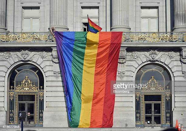 A rainbow flag is lowered over the front of City Hall after the US Supreme Court ruled in favor of samesex marriage in San Francisco California US on...
