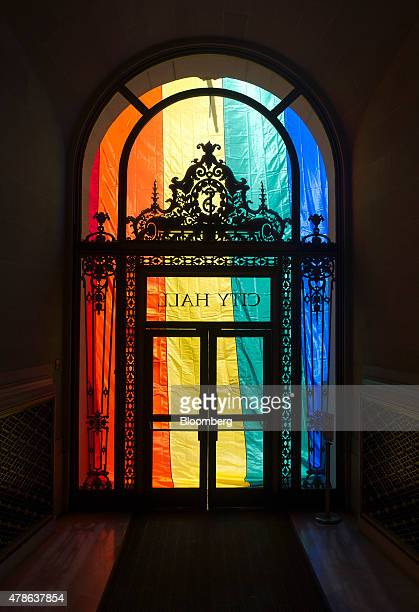 A rainbow flag is seen covering the entrance to City Hall after the US Supreme Court samesex marriage ruling in San Francisco California US on Friday...