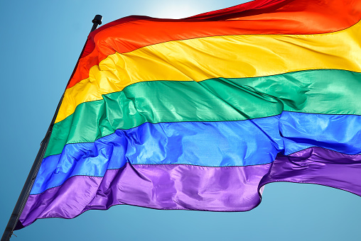 Rainbow flag on clear sky symbol of tolerance and acceptance 847069146
