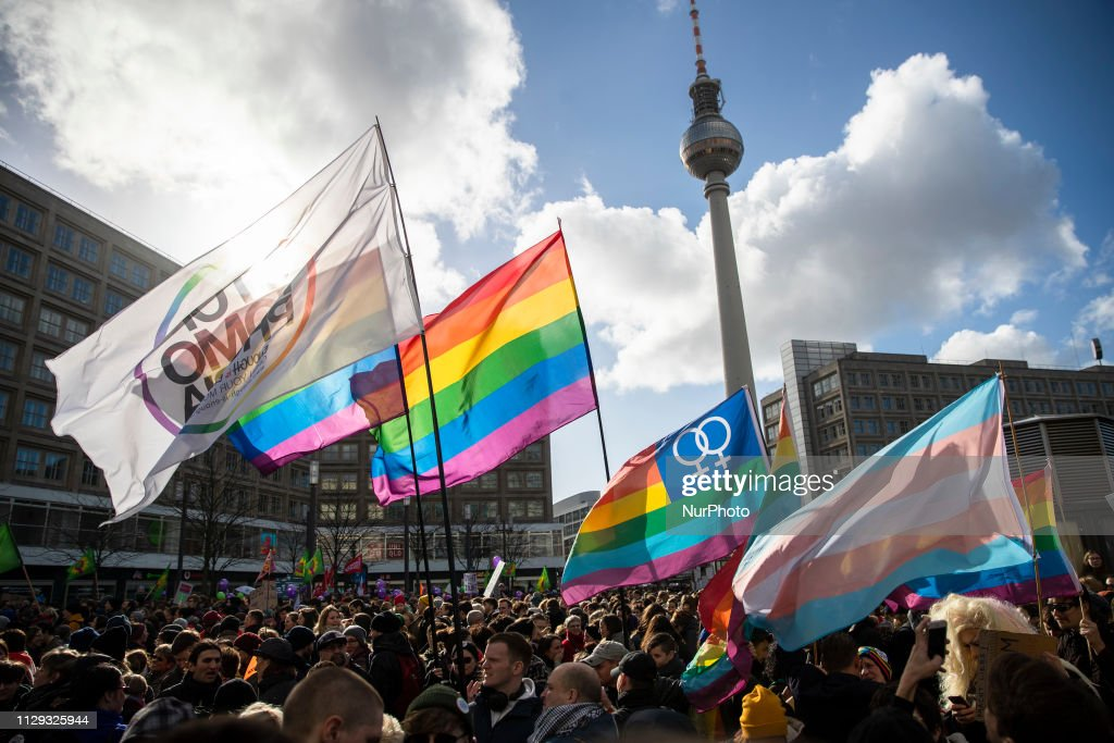 Rainbow flags and banners against homophobia fly during a    News