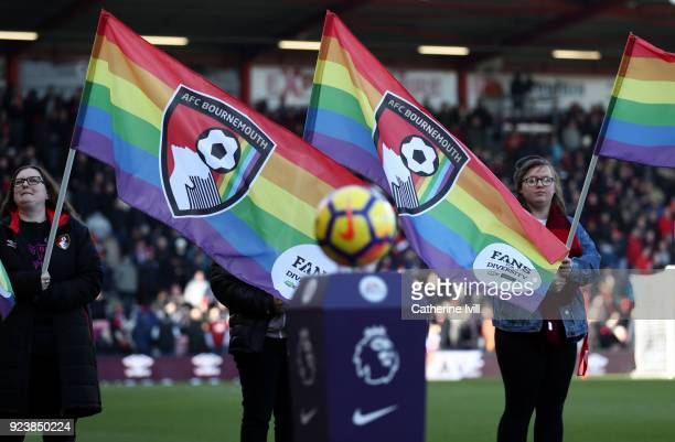 Rainbow flags are held up before the Premier League match between AFC Bournemouth and Newcastle United at Vitality Stadium on February 24 2018 in...