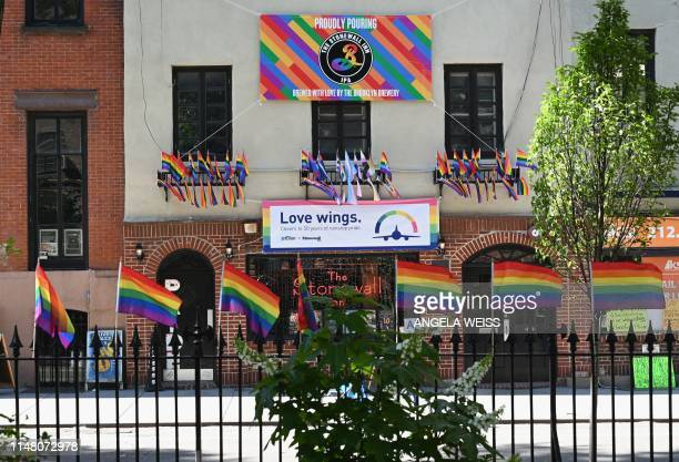 Rainbow flags are seen outside 'The Stonewall Inn' a Gay bar National Historic Landmark and site of the 1969 riots that launched the gay rights...