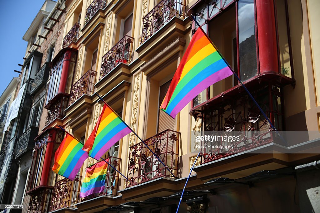 Rainbow flags hanging from balconies in Madrid : Stock Photo