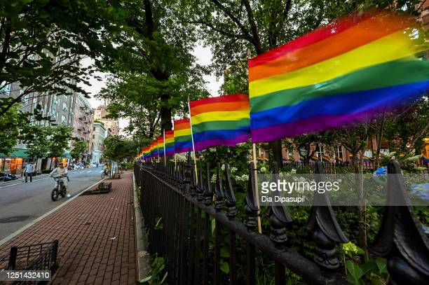 Rainbow flags lined up in a row decorate Christopher Park on June 22, 2020 in New York City. Due to the ongoing coronavirus pandemic, this year's...