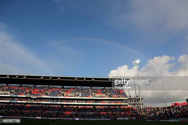A rainbow forms over Hunter Stadium during the round 13 NRL match between the Newcastle Knights and the Wests Tigers at Hunter Stadium on June 8 2014...