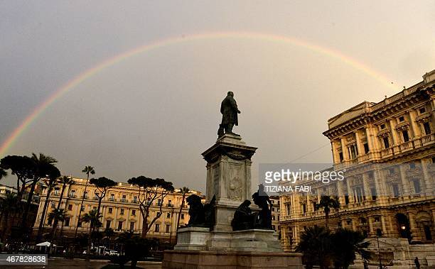 Rainbow forms over Italy's Supreme Court in Rome on 27 March, 2015.AFP PHOTO / TIZIANA FABI