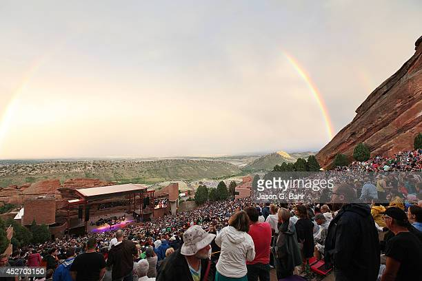 A rainbow forms while Gary Clark Jr performs at Red Rocks on July 25 2014 in Denver Colorado