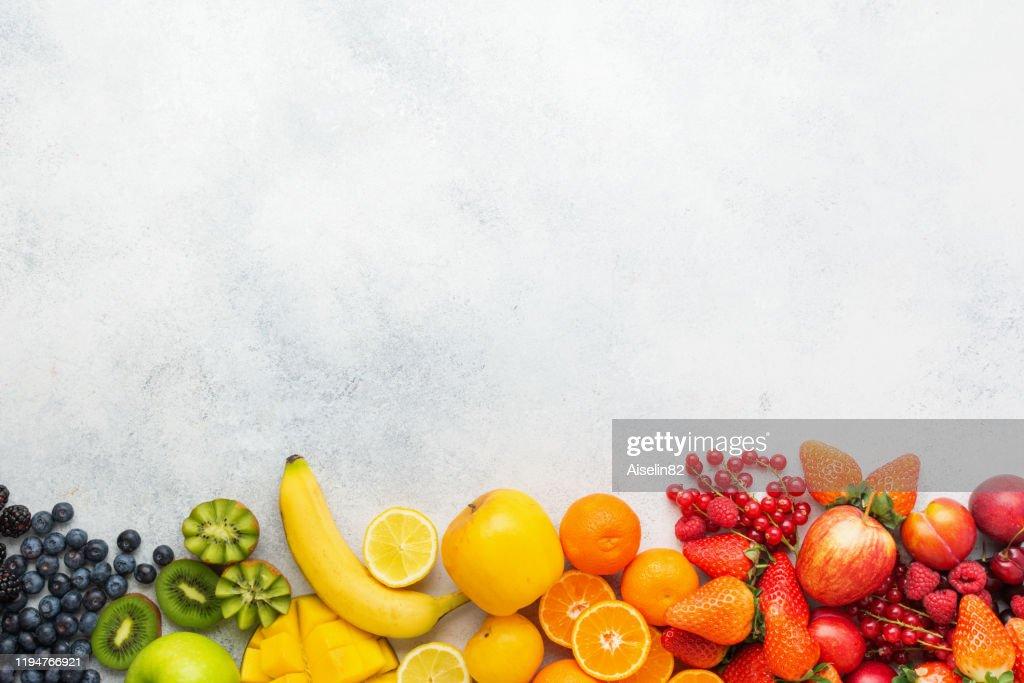Rainbow fruits background : Stock Photo