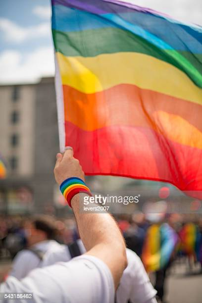 Rainbow gay pride flag and wristband in Pride Parade