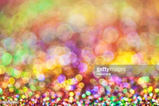 rainbow glitter - february background stock pictures, royalty-free photos & images