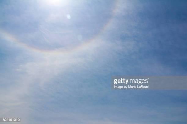 Rainbow halo sun flare in the sky