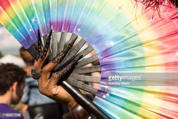 A rainbow hand fan designed by Rudy Jee Van Jee from Stonewall charity to raise money at the UK Black Pride in Haggerston Park in London United...