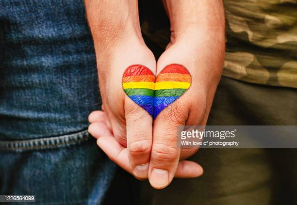 rainbow heart drawing on hands, lgbtq love symbol, gay couple hand in hand, lovers -  lgbtqi ストックフォトと画像