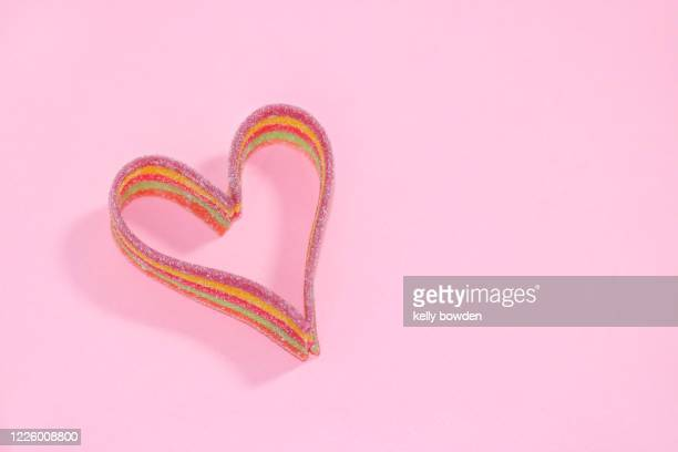 rainbow heart shape sweets lgbt pride - kelly bowden stock pictures, royalty-free photos & images