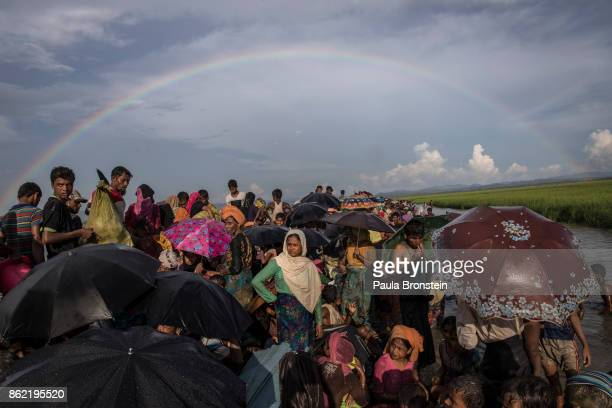 A rainbow hovers above thousands of Rohingya refugees fleeing from Myanmar are kept under a tight security by Bangladeshi military after crossing the...