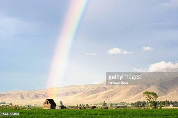 rainbow in a  rural valley in utah - stadje stockfoto's en -beelden