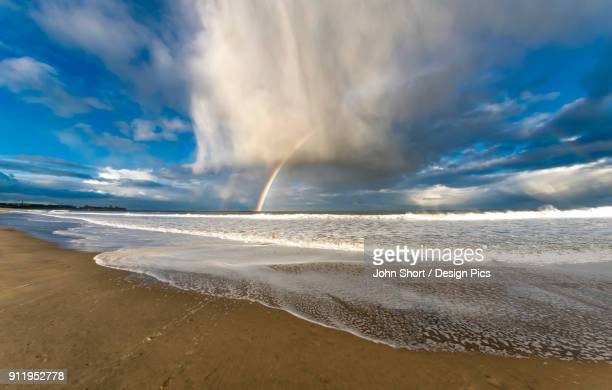 A Rainbow In A Storm Cloud Formation Along The Coast