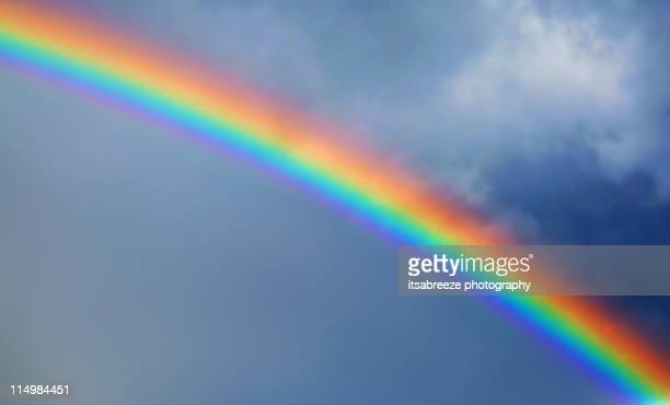 rainbow in stormy sky - rainbow stock pictures, royalty-free photos & images