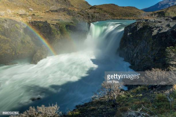 A rainbow in the mist of the Salto Grande Waterfall on the Rio Paine or Paine River in Torres del Paine National Park in Patagonia Chile A UNESCO...