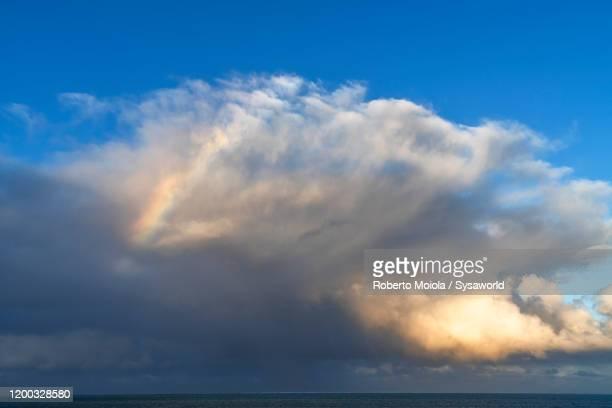 rainbow in the sky at dawn, indian ocean, mauritius - インド洋 ストックフォトと画像