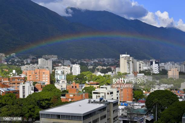 A rainbow is backdropped against the hill of Avila after a rainy day in Caracas on November 12 2018