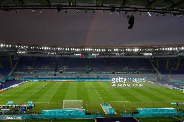 Rainbow is seen above the Olympic Stadium in Rome on June 10 during a training session for the Turkish national team on the eve of the UEFA EURO 2020...