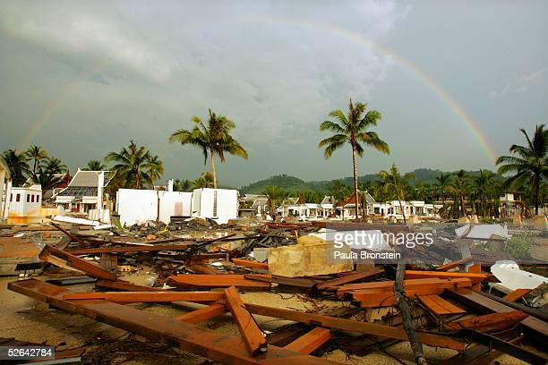 A rainbow is seen after a rainstorm over the rubble and debris still left untouched at the Mukdara Beach resort April 17 2005 in Khao Lak Thailand...