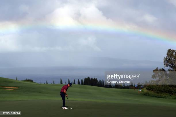Rainbow is seen as Brian Gay of the United States putts on the fourth green during the first round of the Sentry Tournament Of Champions at the...