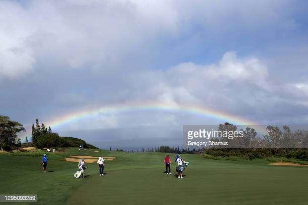 Rainbow is seen as Brian Gay of the United States walks on the fourth green during the first round of the Sentry Tournament Of Champions at the...